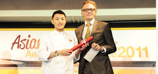Vincent Bourdin, Regional Pastry Consultant from Valrhona Far East Singapore Office presenting Vincent Tan Sau Jin from SHATEC Institutes with the Valrhona ...